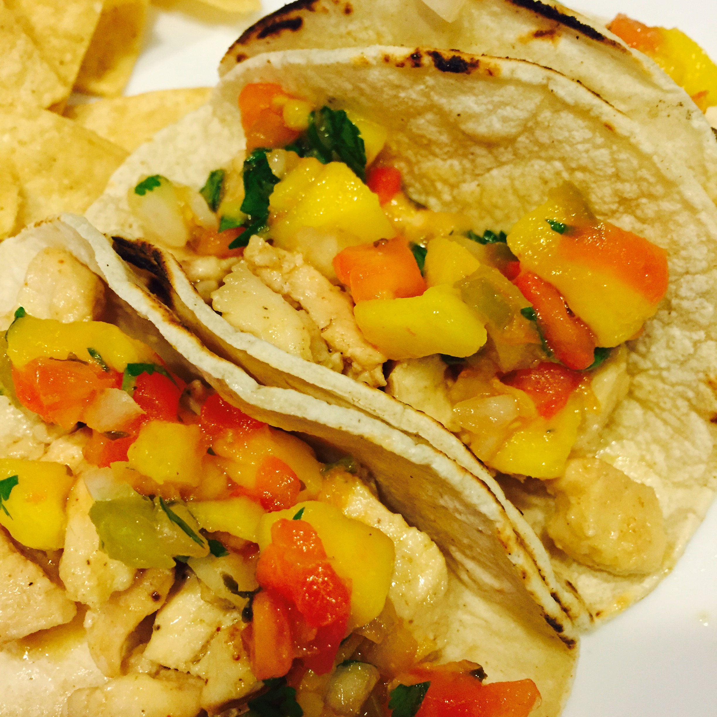 Chicken Tacos Topped With Mango Salsa